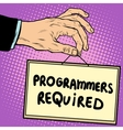 Hand holding a sign programmers required vector image vector image