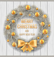 white christmas wreath on a wooden background vector image vector image