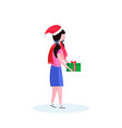 woman wearing hat holding gift box happy new year vector image vector image