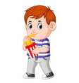 young boy eating french fries vector image vector image