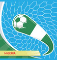 nigeria waving flag and soccer ball in goal net vector image vector image