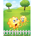 A hilltop with an orange monster playing with a