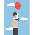 Businessman flying away with balloon but being hin vector image vector image