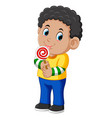 curly boy licking a lollipop vector image