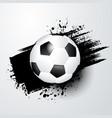 Footballsoccer ball with splash in the background