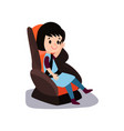 cute little brunette girl sitting on a car seat vector image