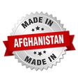 made in Afghanistan silver badge with red ribbon vector image vector image