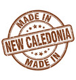 made in new caledonia brown grunge round stamp vector image vector image