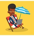 Businessman working on laptop at the beach vector image vector image