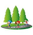 three kids riding bikin on road vector image vector image