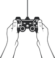 Gamepad in hands icon - game console joystick vector image