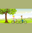 two people ride a bike through the countryside vector image