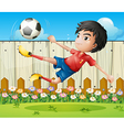 A boy playing soccer inside the fence vector image vector image