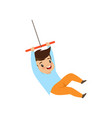 cute little boy having fun on a rope swing vector image vector image