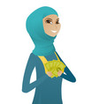 young muslim business woman holding money vector image vector image