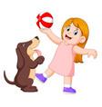 young girl playing ball with dog vector image