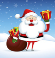 Santa Claus holding a gift box in Christmas snow