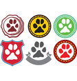 Dog paw emblem vector image