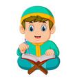 boy with green caftan is reading al quran