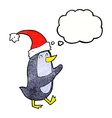 cartoon christmas penguin with thought bubble vector image vector image
