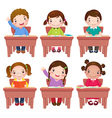 School kids sitting on table vector image