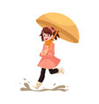 kid girl under umbrella jumps in puddle in rain vector image vector image