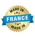 made in France gold badge with blue ribbon vector image vector image