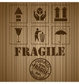 Wooden shipping box with fragile signs and stamp vector image