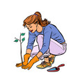 woman working in the garden planting a seedling vector image