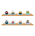 Eight cupcakes at the wooden shelves vector image