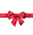 Red bow with red ribbon isolated on white