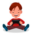 cheerful little boy playing videogames cute vector image