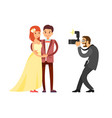 photographer taking photos of just married couple vector image vector image