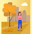 woman enjoying with falling leaves autumn scenery vector image
