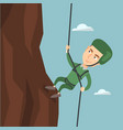 man climbing a mountain with a rope vector image vector image