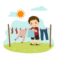 a little boy hanging laundry on backyard vector image vector image