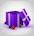 purple gift box with christmas toy vector image