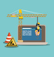 website under construction with laptop vector image vector image