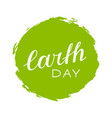 handwritten lettering of earth day on green vector image