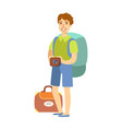 young tourist man standing with big tourist vector image vector image