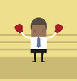 african businessman with his boxing gloves vector image vector image