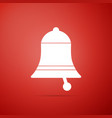 ringing bell icon isolated on red background vector image vector image