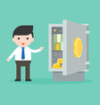 businessman showing banknote and gold in safe box vector image