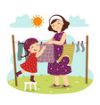 mother and daughter hanging laundry vector image vector image
