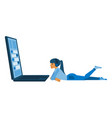 young girl lying behind big laptop screen vector image