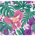 tropical flowers and palm leaves seamless pattern vector image vector image