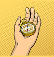 Compass in hand pop art vector image