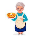 grandmother holding a delicious pumpkin cake vector image vector image