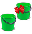 green plastic bucket with a black handle isolated vector image