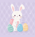 happy easter cute rabbit with decorative eggs vector image